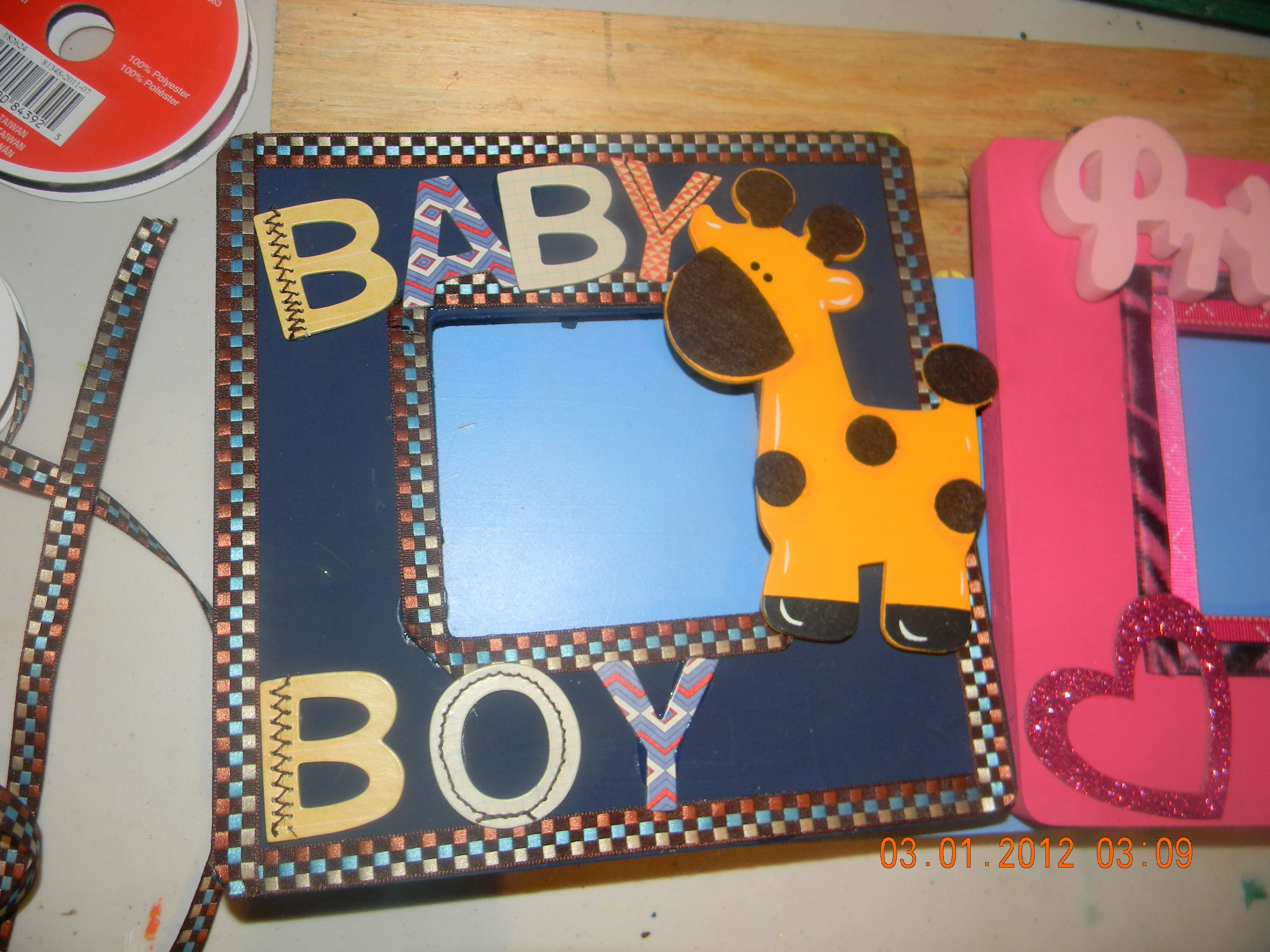 Baby boy picture fram made w/ paint, ribbon, wooden giraffe and wooden letters