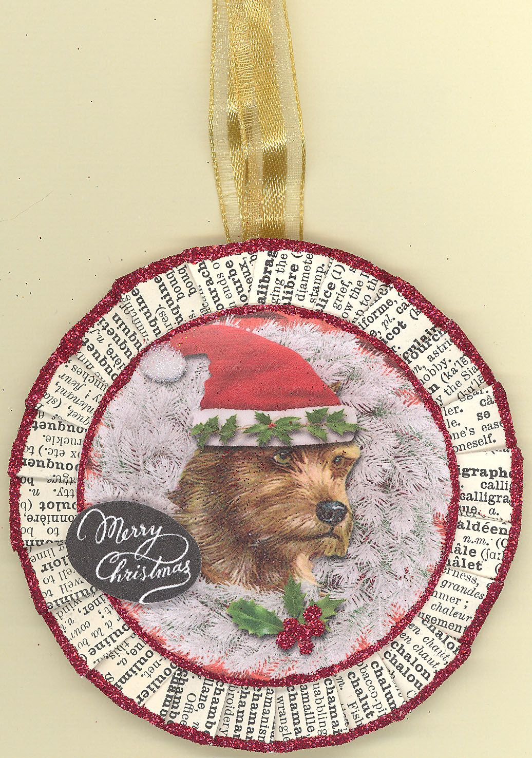"""Rat Terrier. Measures approx. 3"""" in diameter without the ribbon hanger which is about 1.5"""". The back side is a painted wooden circle that is signed and dated by the artist. The rosette is folded by hand and is made from papers from a 1932 French Dictionary, edges are glittered with ArtGlitter. Hang on a wreath, package, garland, door, tree or light. A perfect gift for you or a dog lover in your life. Convo me if you want different dog breed, it may be possible to custom order one from me."""