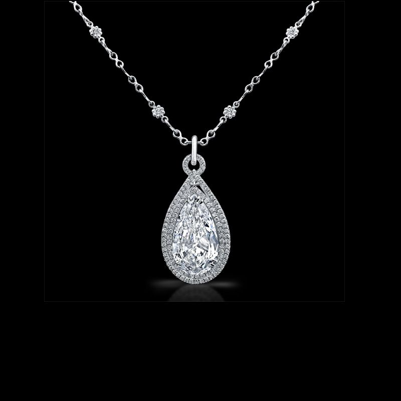 Pear shape diamond pendant with diamond pave in platinum.  By Norman Silverman.  Available at Alson Jewelers.