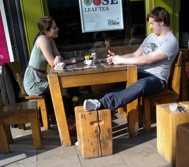 woman brunette and man sitting outside cafe couple romance Chiswick high Road London 23rd March 2011 15:16.50pm      See  this image .  Aaaah!