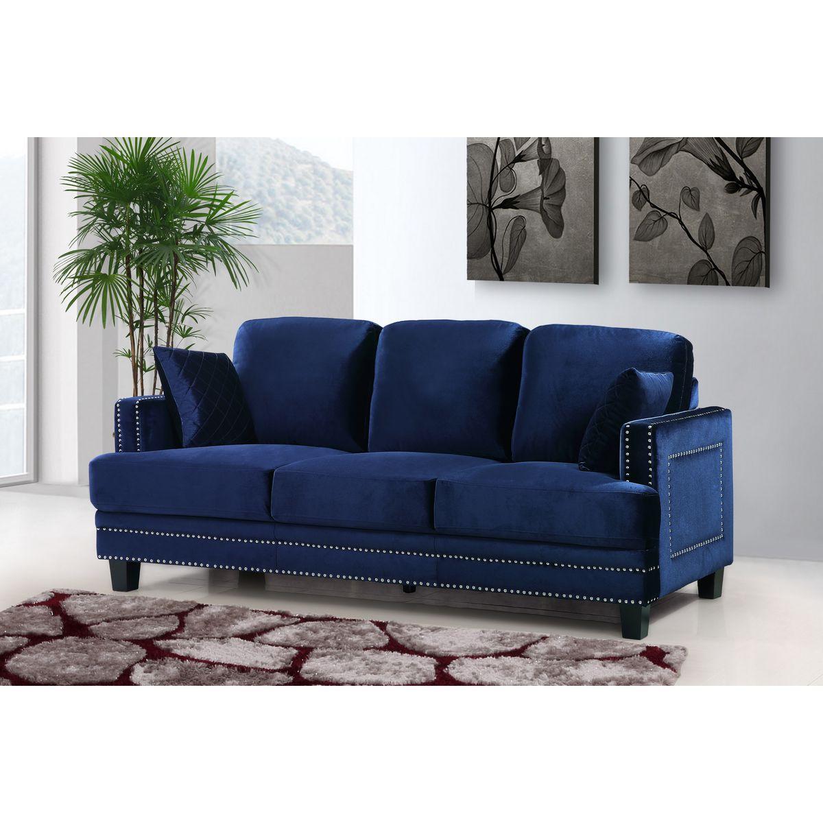 Navy Velvet Sofa w/ Silver Nailhead & Quilted Pillows #dynamichome #sofa #navy #velvet #fabric #transitional #modern #contemporary #nailhead #blue #livingroom #interiors #interiordesign #homedecor #color #greatroom #familyroom
