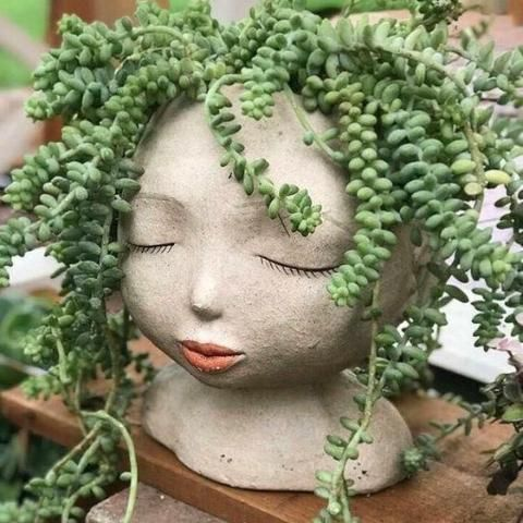 Lady of the Forest Head Planter is part of Plants - Give your plants a home with this Lady of the Forest headshaped planter  These plant pots are handcrafted out of resin  Each one is individually painted and may vary slightly  Measures 8  W x 9  H Lightweight & Durable Made of Resin