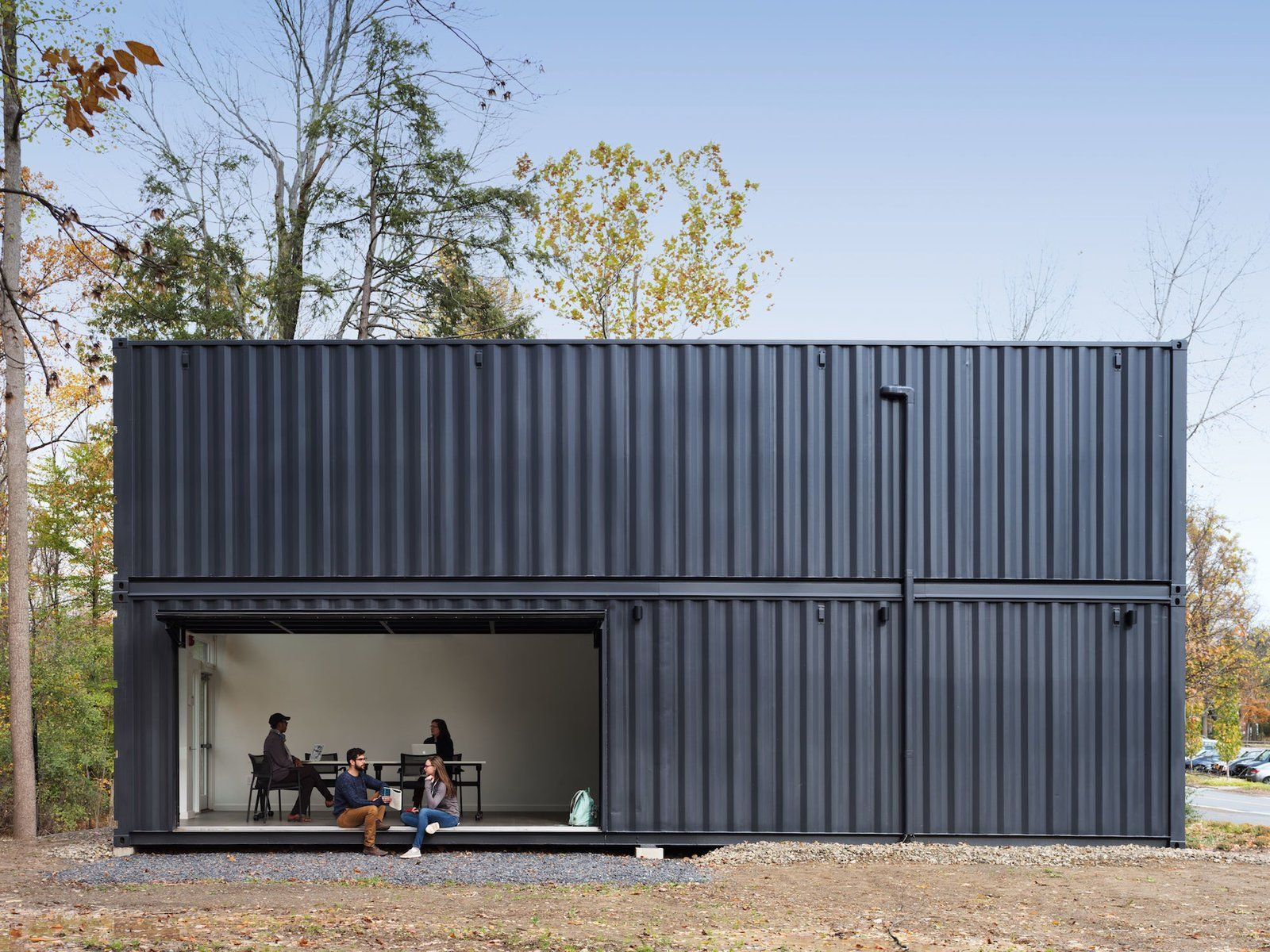 The Main Room Opens To The Quad Through A Large Pivoting Garage Door Tagged Exterior Shipping Contai Architecture Container House Container Architecture