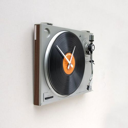 """This clock was created using a recycled Sanyo turntable and a Ronco's Greatest Hits album titled """"Get It On"""" which is replaceable. (Designed by pixelthis)"""