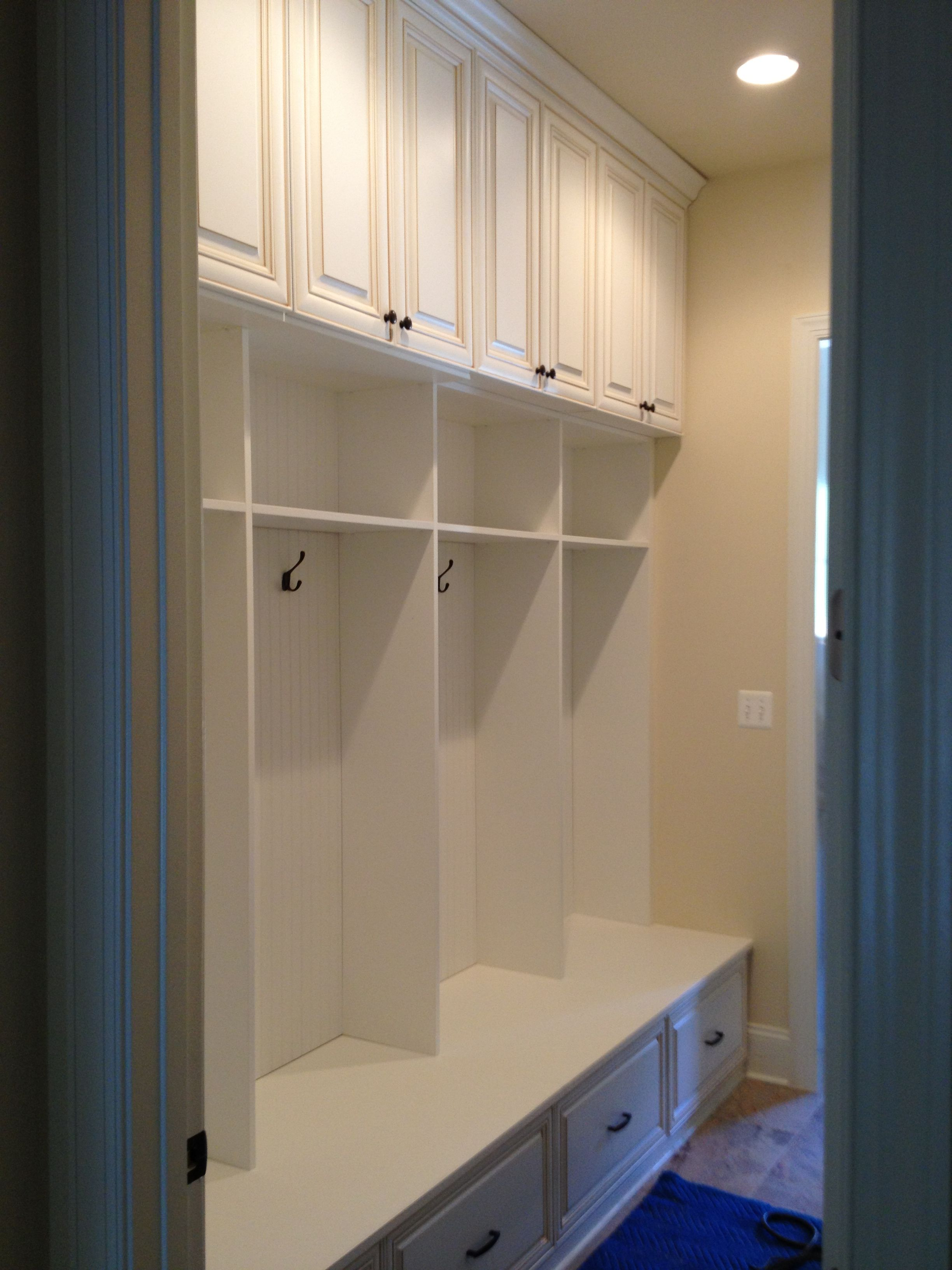 White Wood Locker Style Mudroom With Overhead Cabinets