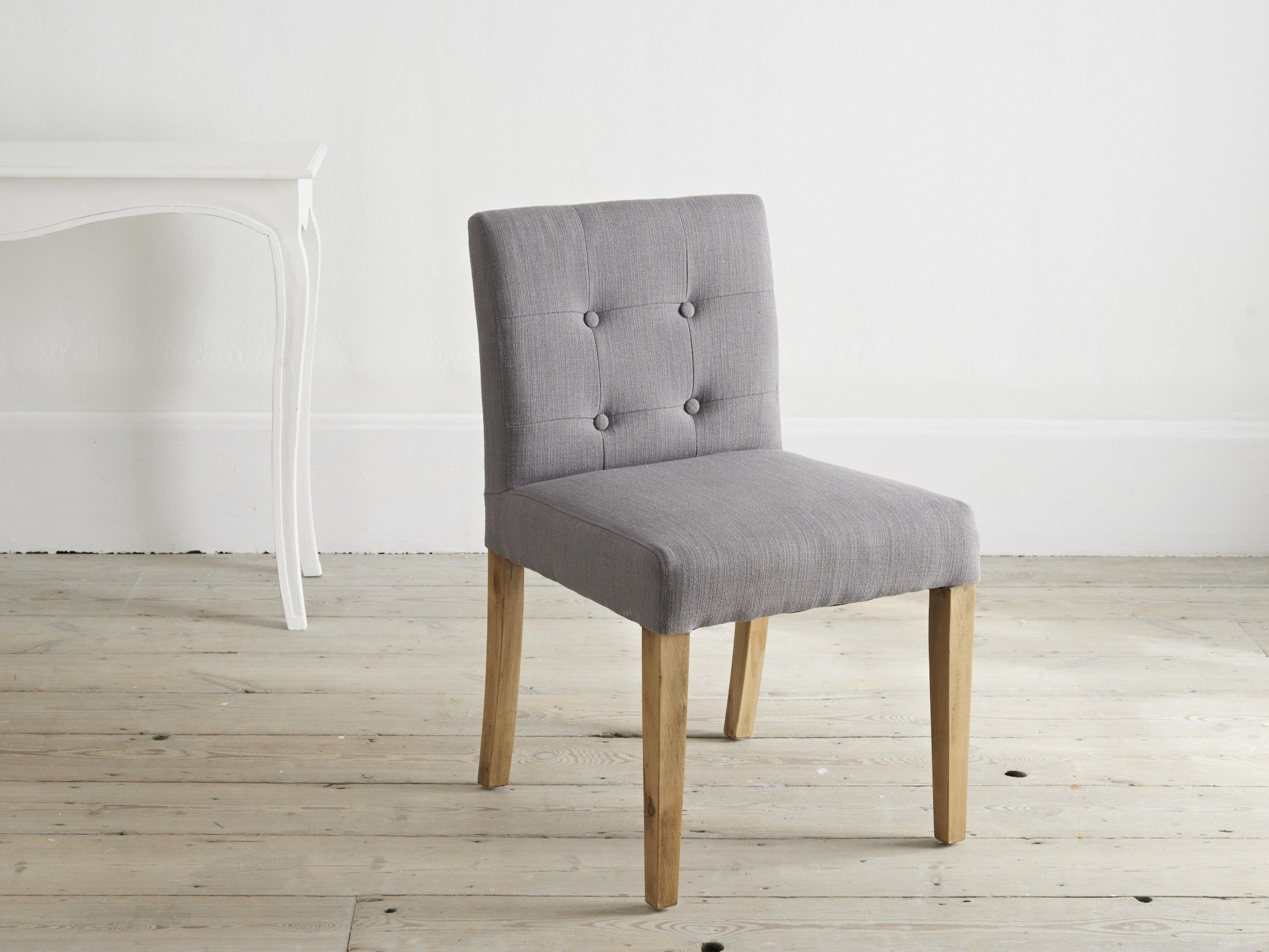 A Stunning Low Back Dining Chair With Birch Legs And Textured Grey Linen Upholstery Chequerboard Stitch Detailing Four Perfectly Placed Buttons