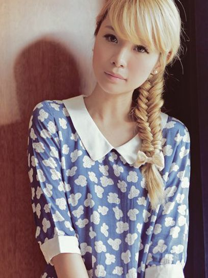 Hair tip: Adorn a stylish fishtail braid with a bow for an extra kick of cute.