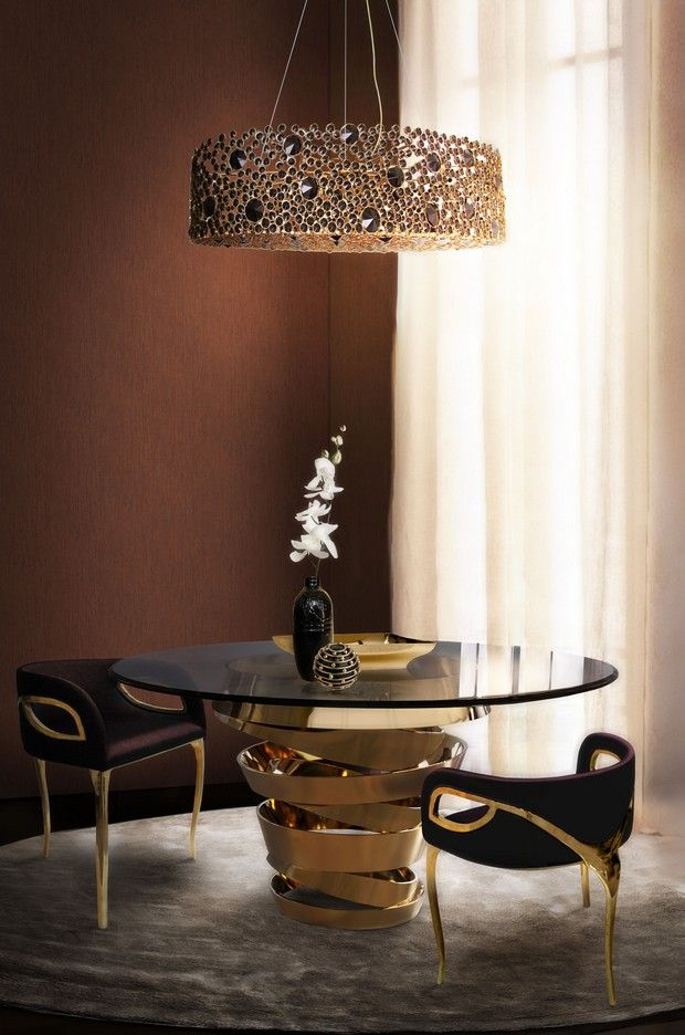 A beautiful dining area with the intuition dining table and eternity chandelier by koket diningrooms