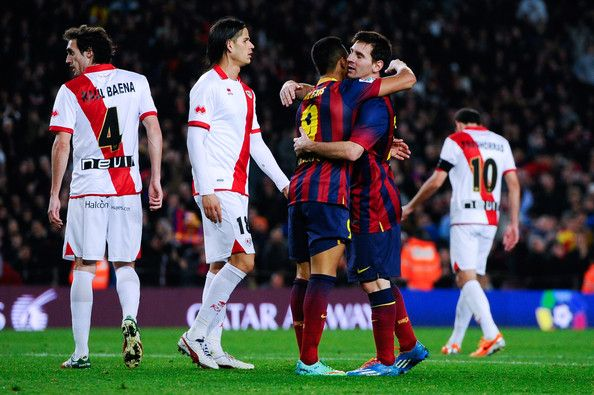 Alexis Sanchez of FC Barcelona celebrates with his teammate Lionel Messi after scoring his team's third goal during the La Liga match between FC Barcelona and Rayo Vallecano de Madrid at Camp Nou on February 15, 2014 in Barcelona, Catalonia.
