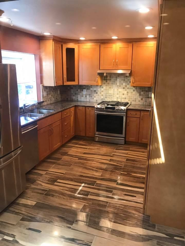kitchen remodel with black granite maple shaker cabients natural stone backsplash recessed on kitchen remodel appliances id=13692