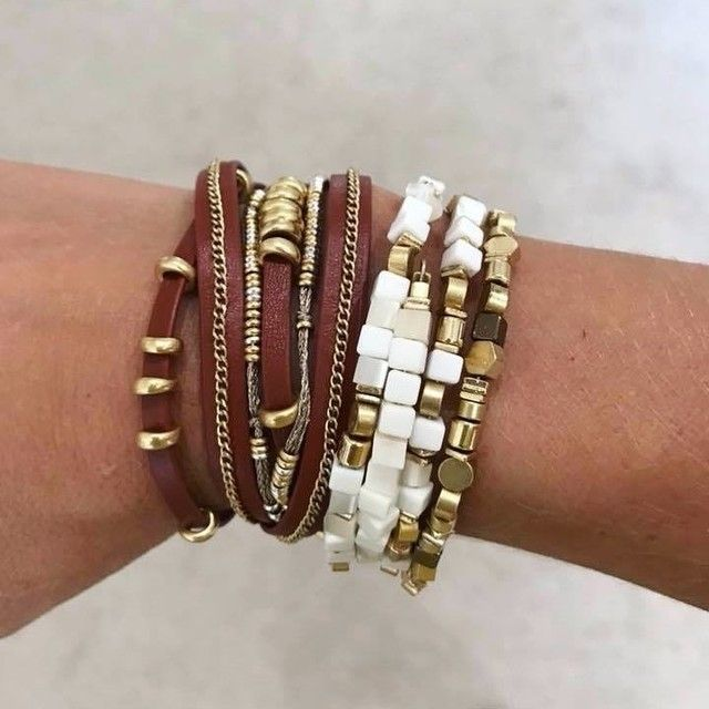 af8df8004f5 Gia Coil Bracelet | $58Shiny and vintage gold, bronze, and white  alternating dimensional beads coil into a spiral bangle. Mini drops  delicately hang from ...