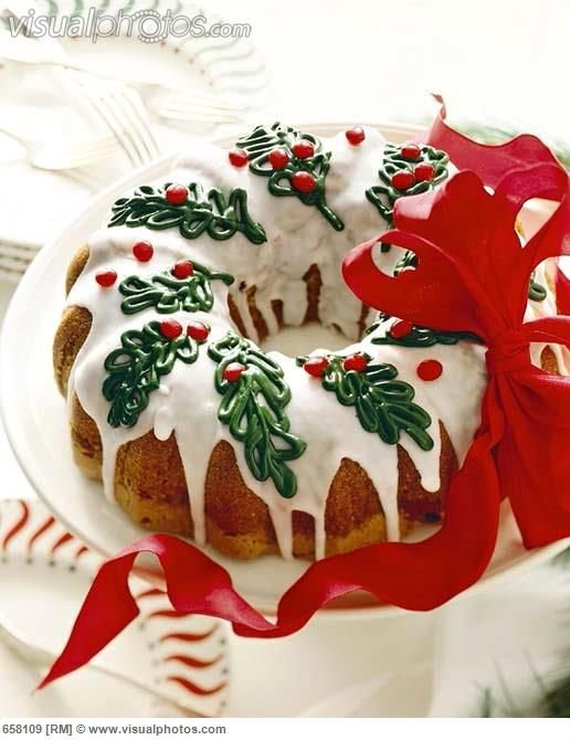 Christmas Bundt Cake With Icing And Holly Decorations Ribbon
