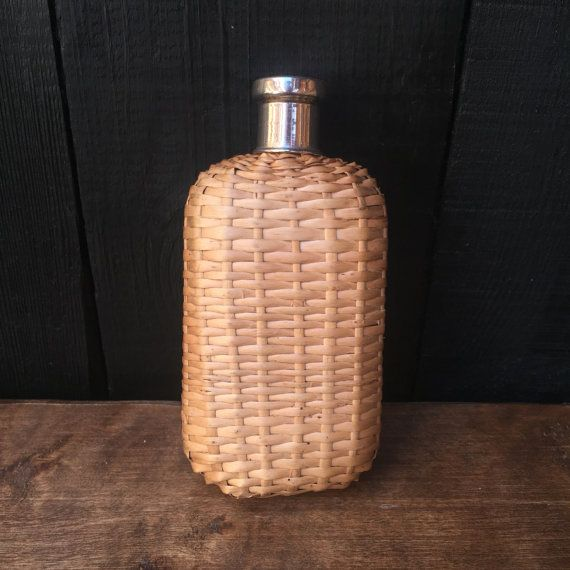 GLASS HIP FLASK - Glass bottle in a woven case, metal cap with a cork inner.