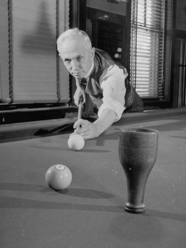 Man Playing Billiards Premium Photographic Print at Art.com