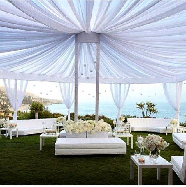 Outdoor Reception Tent With White Lounge Furniture.