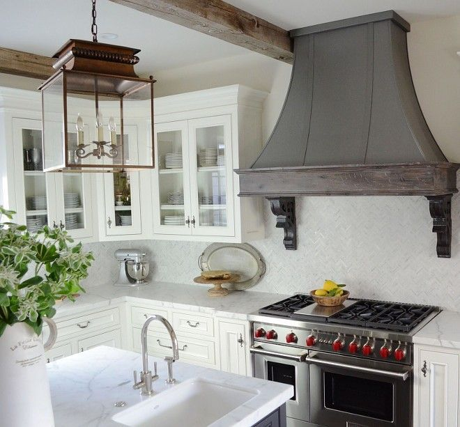 Range Hood, glass front cabinets, and Carrera Marble countertops ...