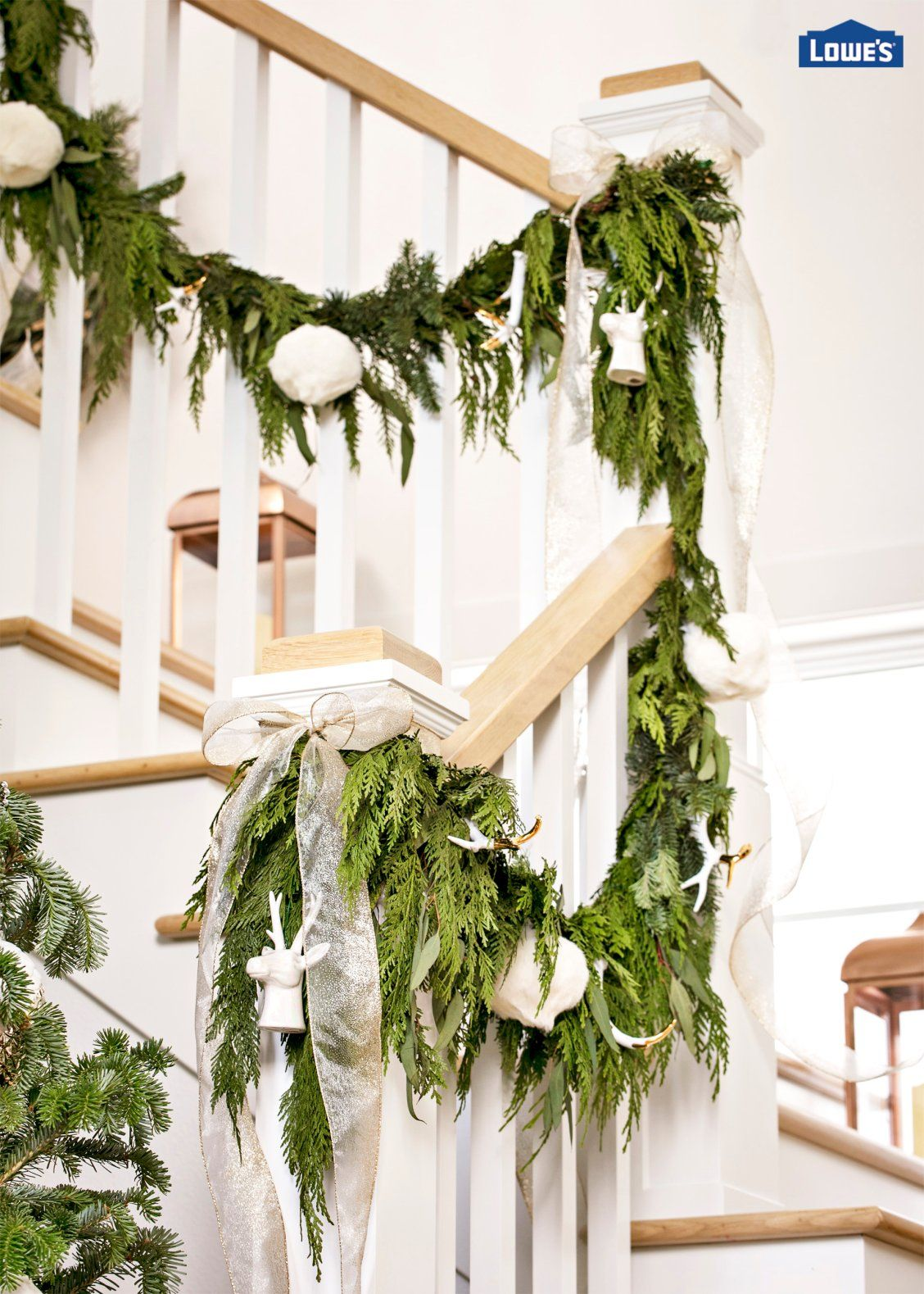 Greenery Wrapped Banisters Adorned With Metallic Ribbon And Antler  Ornaments Create An Eye Catching Effect Images