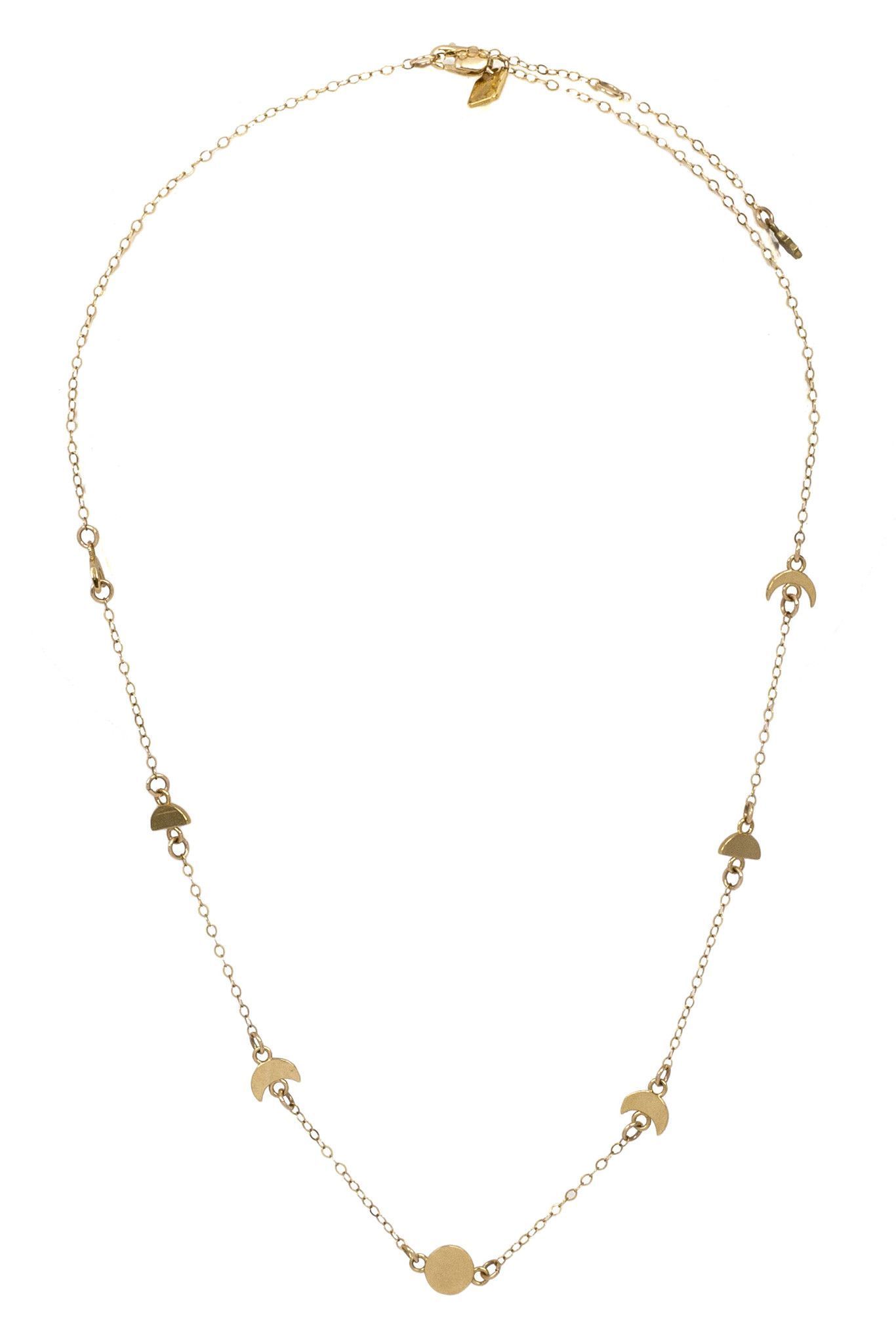 """The Ara Moon Phase Choker is celestial-inspired piece with a touch of geometric styling. The combination of magical influence and short length make this necklace a definite eye-catcher.Measures 15.75"""" in length with a 2"""" extender.Gold fill chain with gold plated Sterling Silver pendants or Sterli..."""