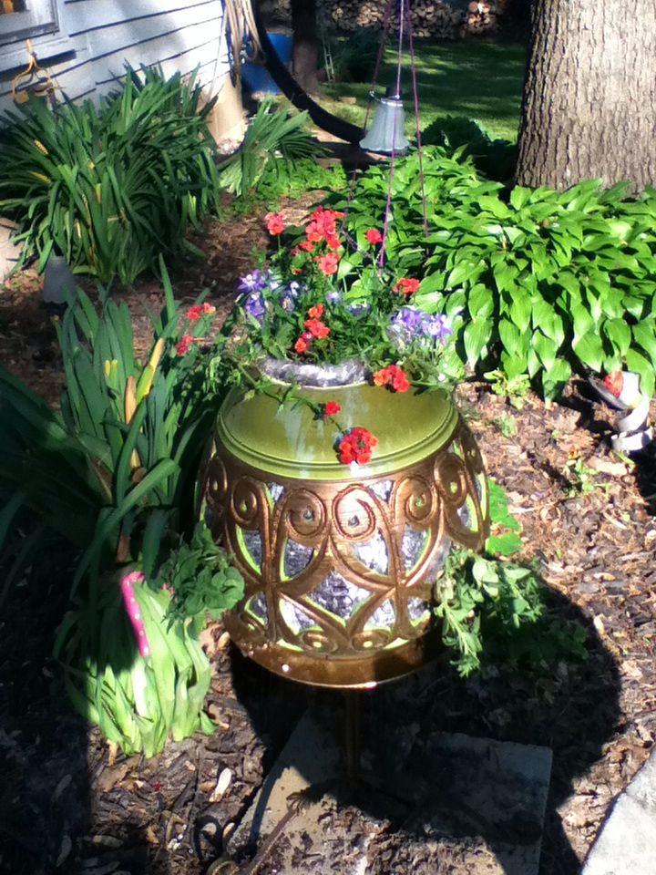 The base of 1970 's lamp....turned in to planter