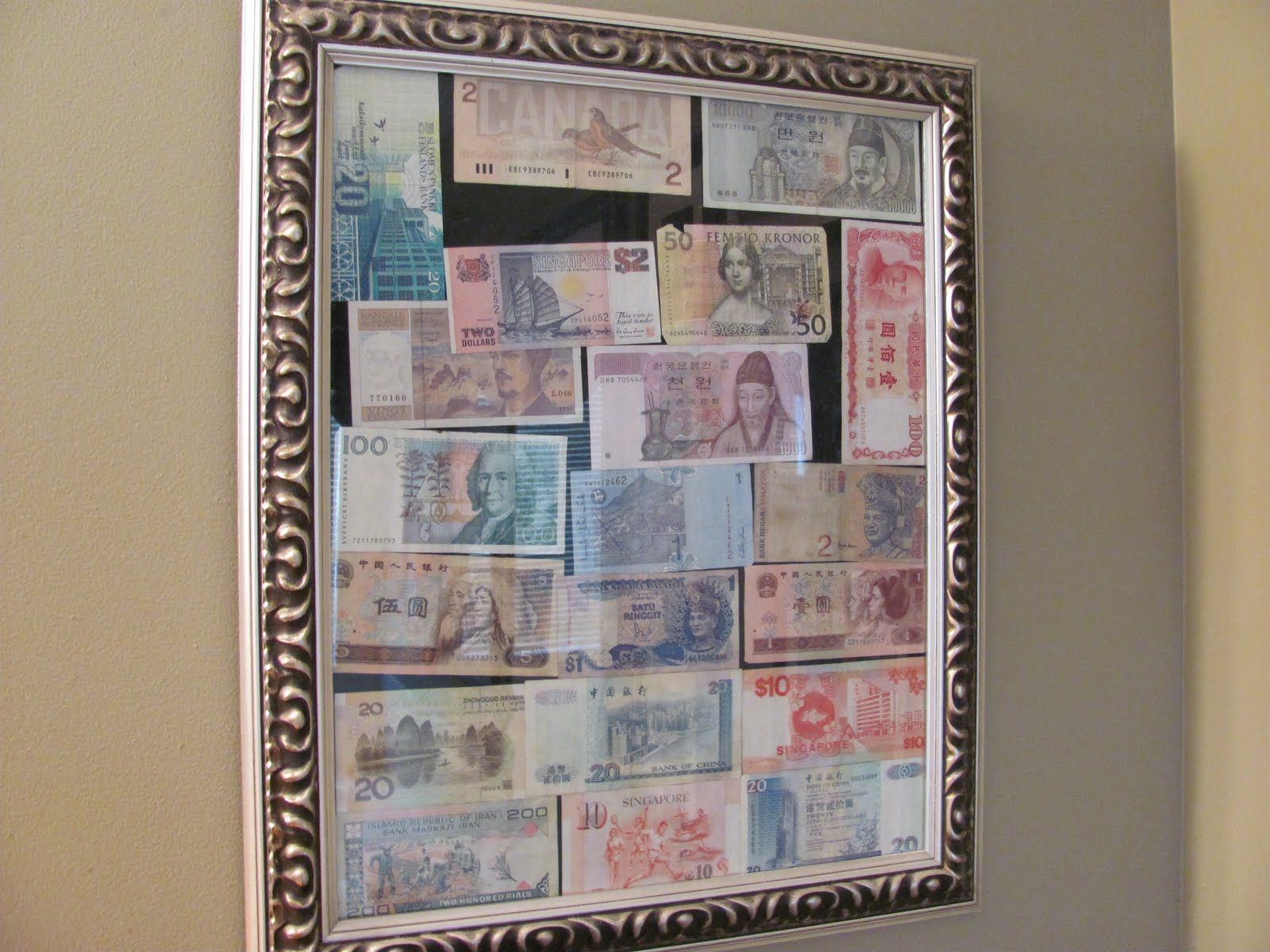 displaying leftover foreign currency header using travel souvenirs in decorating - Travel Home Decor
