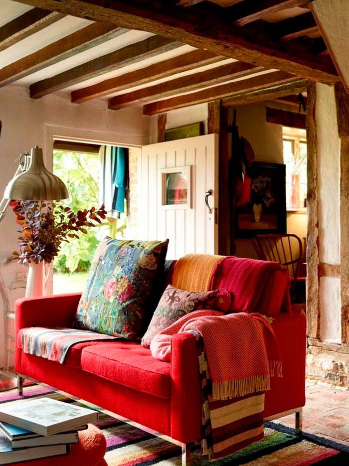 This Red Couch With Colorful Pillows Brings So Much Cheer