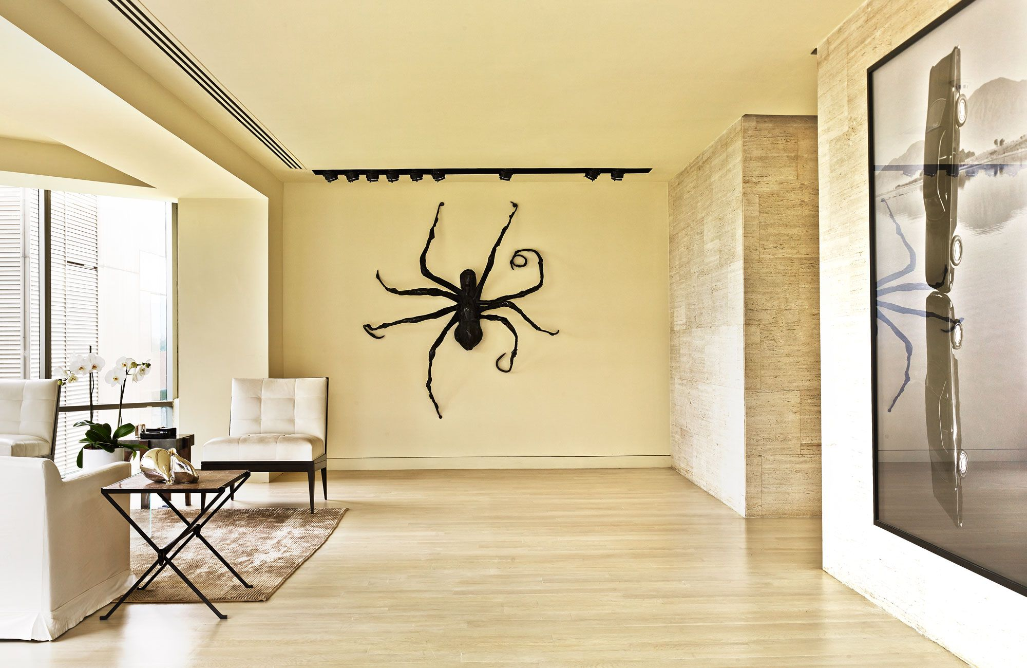 Art Nuevo - Spider IV, 1996, by Louise Bourgeois, and Gonzalo Lebrija's Entra la Vida y la Muerte, 2008, in the small foyer of Lopez's Mexico City apartment.