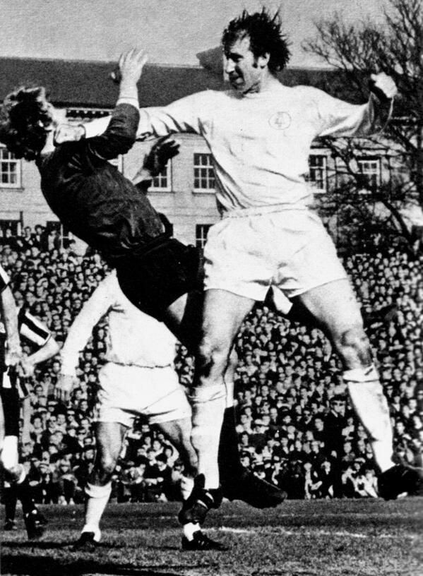 1969/70. Leeds United's Jackie Charlton challenges Newcastle's Willie McFaul