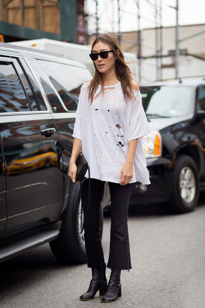 dff06f2212f Black cropped flares worn with leather ankle boots and an oversized  distressed t-shirt