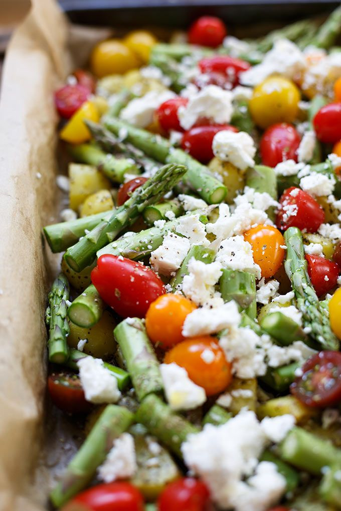 Photo of Baked potatoes with green asparagus, tomatoes and feta