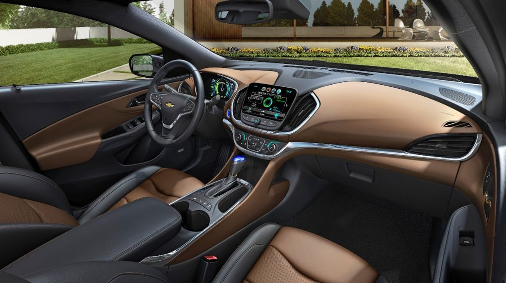 The 2016 Chevy Volt Can Now Go 50 Miles On Its Electric Battery Alone Chevy Volt Chevrolet Volt Chevy Volt Interior