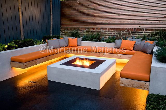 Chill Out Garden | Contemporary seating with timber benches and firepit | Charlotte Rowe Garden Design
