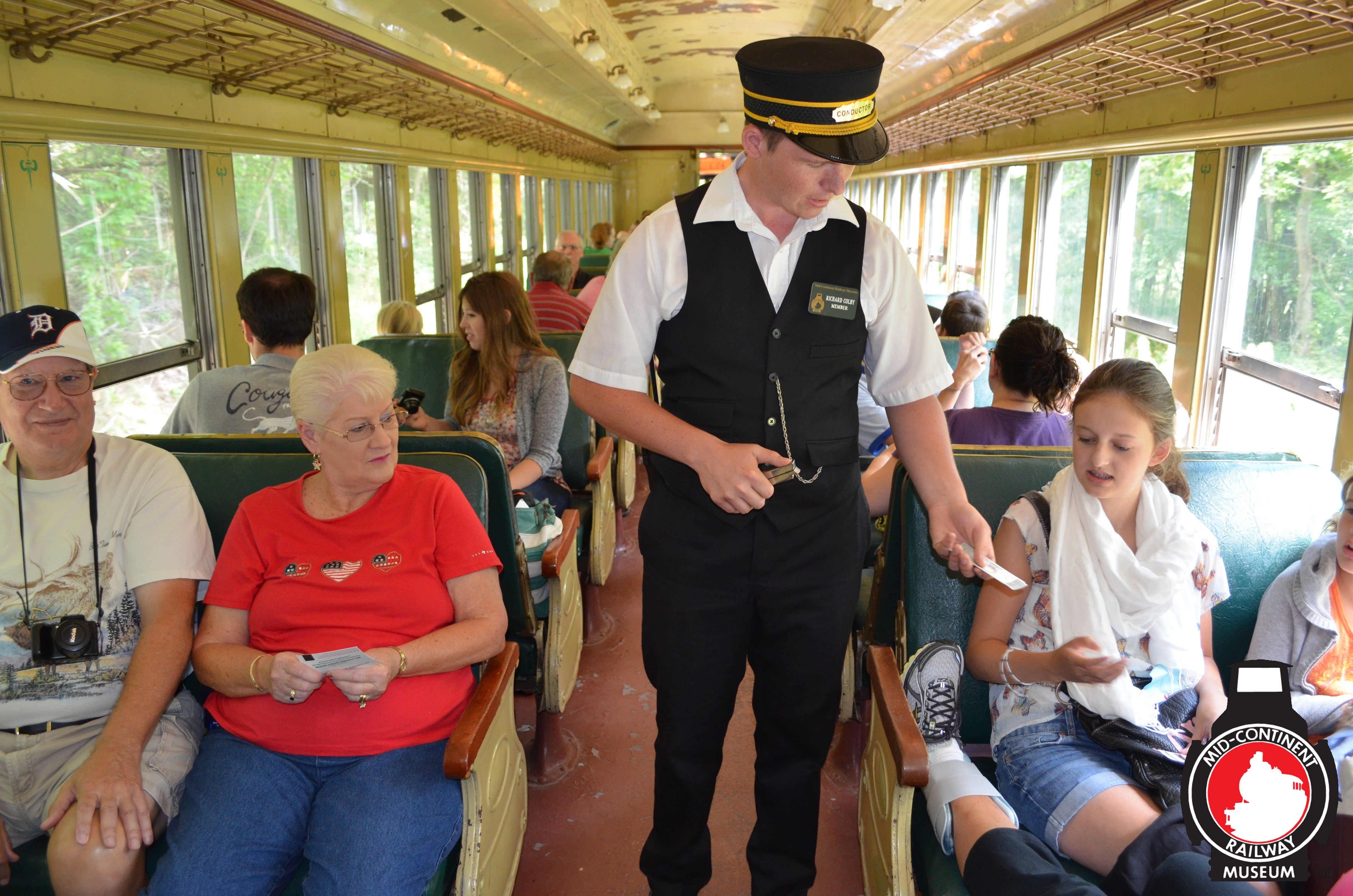 Conductor Collecting Tickets At Mid Continent Railway Museum In North Freedom Wi Mid Continent Railway Museum All Ride