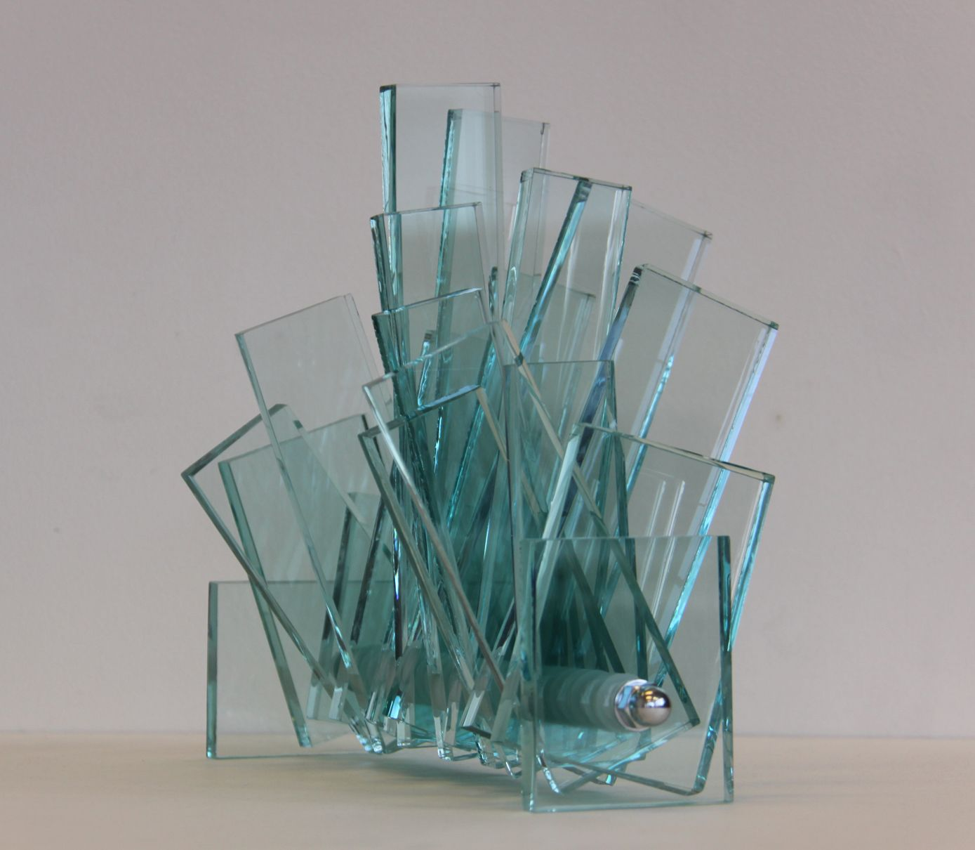 glass statues | MOBILIS A – 28,5 x 8(23) x 10(39) glass sculpture. Just plain glass from a window. Amazing that is looks so nice.