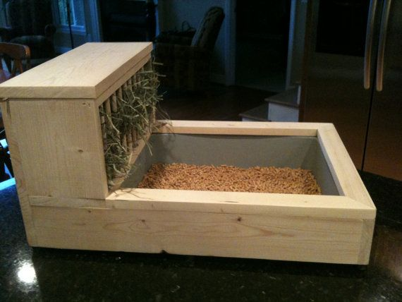 Rabbit Litter Box / Hay Feeder - 2 Free Chew/Toss Toys Included. $60.00, via Etsy.