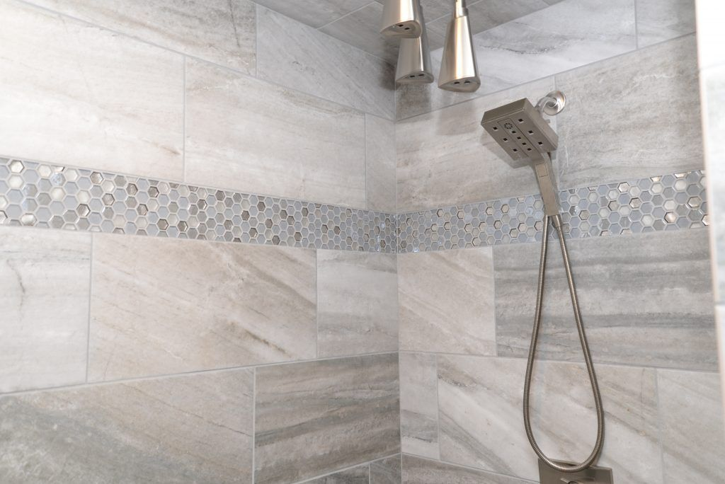 Gray Tiled Shower With Gray And Blue Hexagon Tile Accent Shower