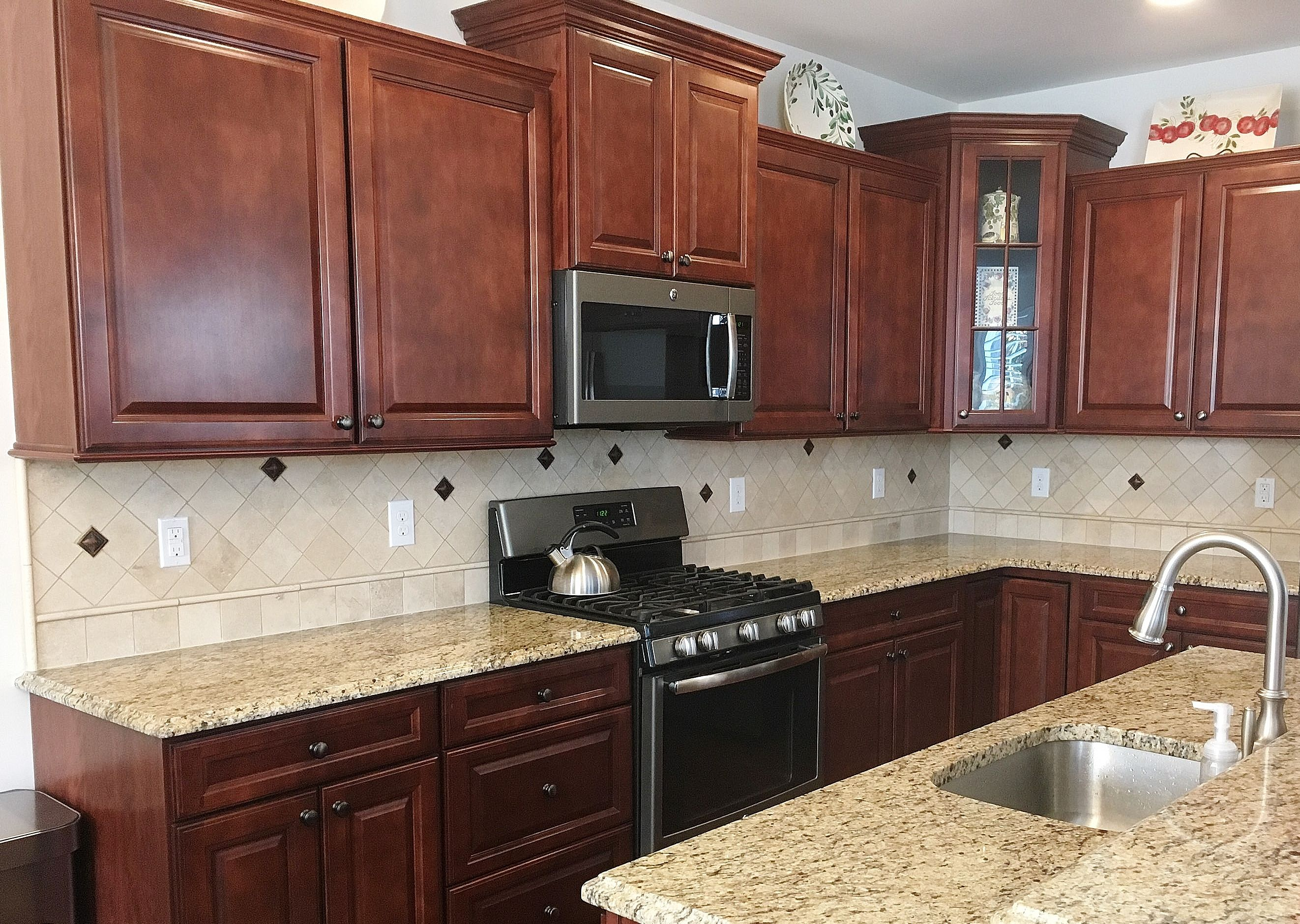 Warm Kitchen With Santa Cecilia Granite Countertops