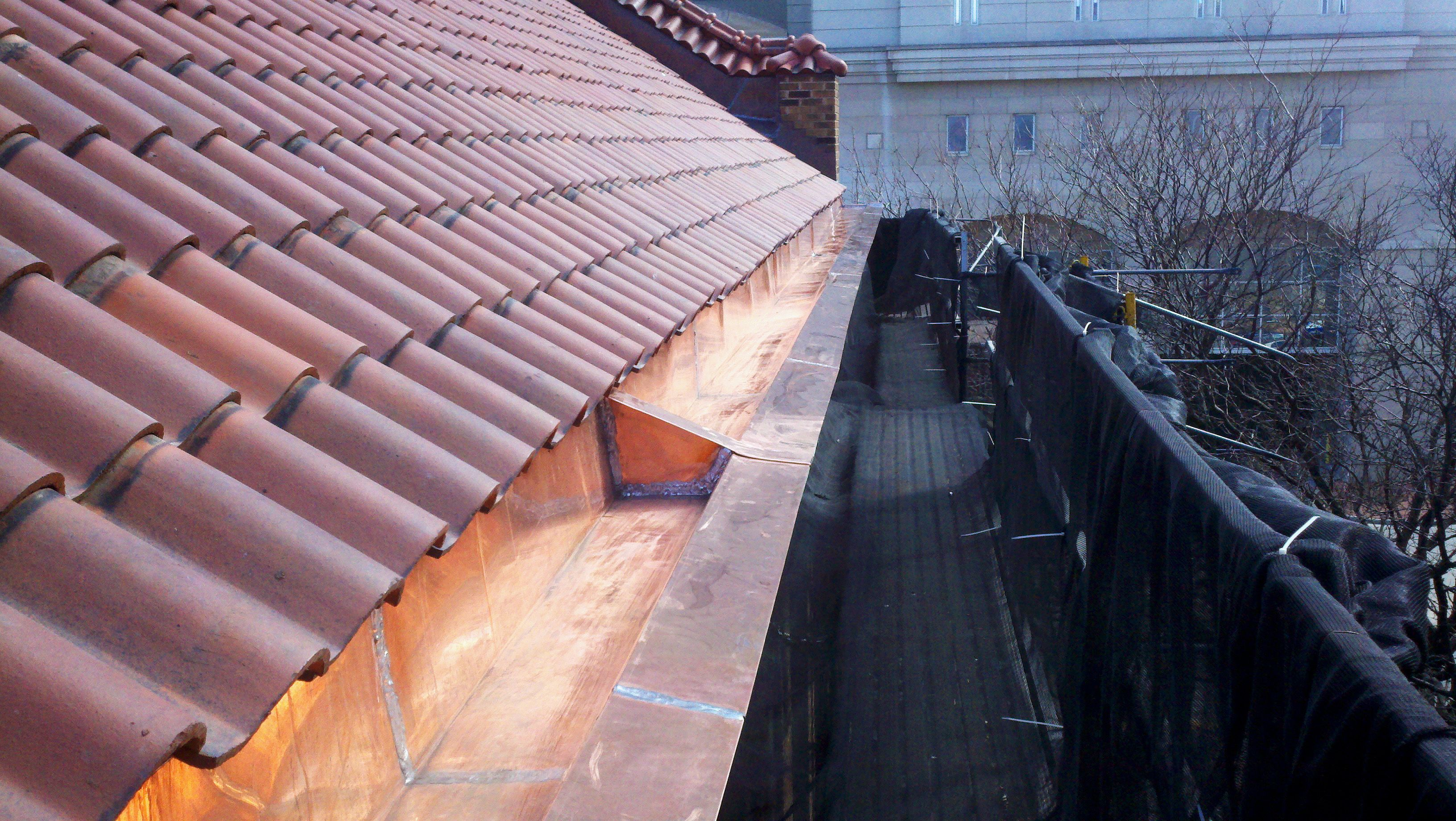 New built in copper gutters on church in milwaukee with a for Clay tile roofs