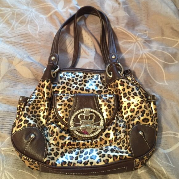 Kathy VanZeeland cheetah purse Excellent condition! Cheetah purse. No stains in side. Great condition outside. No stones missing or scratch marks. Must have purse! Pockets everywhere inside and on outside. Kathy Van Zeeland Bags Shoulder Bags