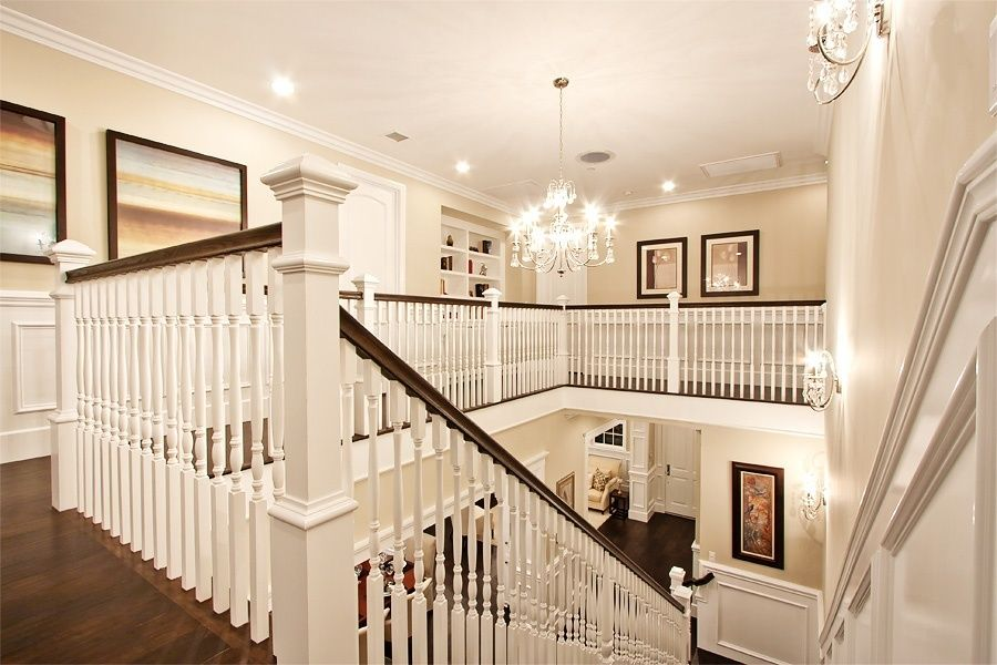 Traditional Staircase With Ceiling Molding Chandelier