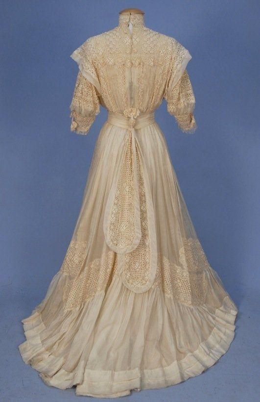 TRAINED SILK and LACE HIGH NECK GOWN, c. 1900. - Apr 27, 2013 | Charles A. Whitaker Auction Co. in PA