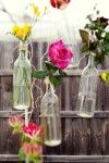 Cute idea for hanging bottles with flowers in. Think it would work inside as well as out