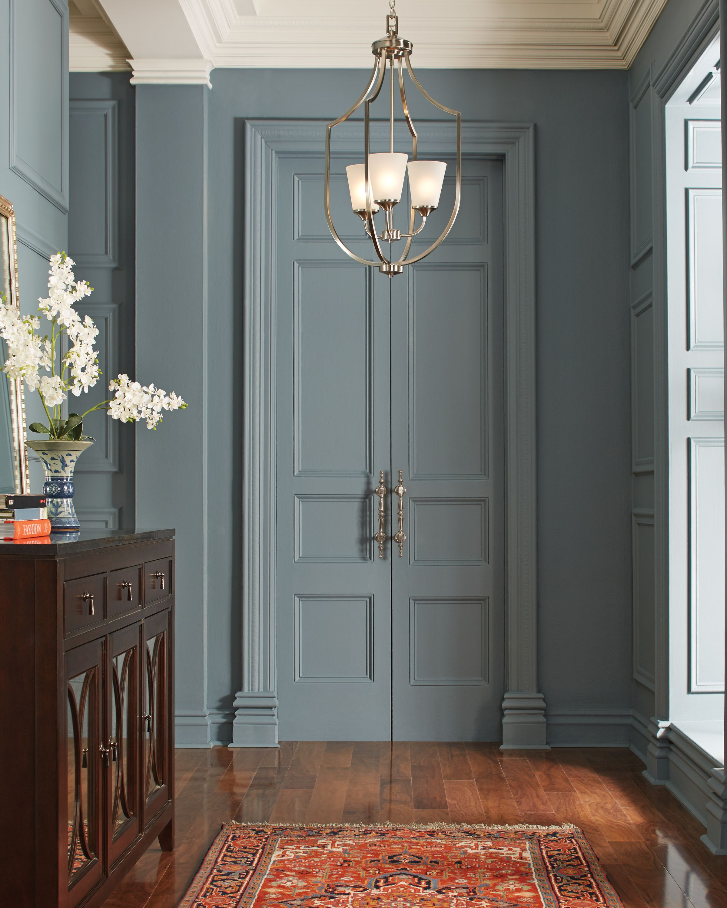 Transitional Foyer Hallway: Elegant Long Arms Create Symmetry In The Transitional