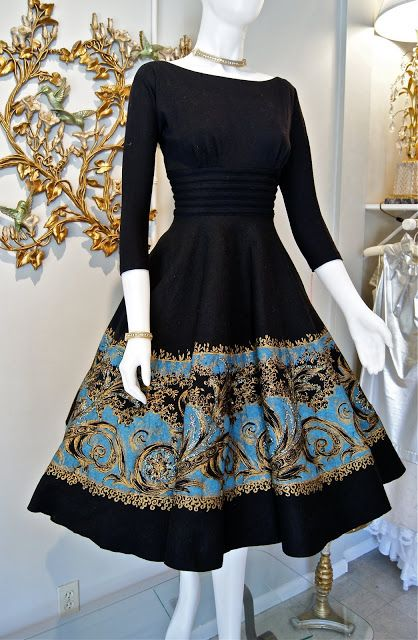 """This was in Miss Elliette's fashion heyday. Made in the 1950's and featuring a """"New Look"""" sillouette with a full felt circle skirt and fitted wool jersey bodice."""