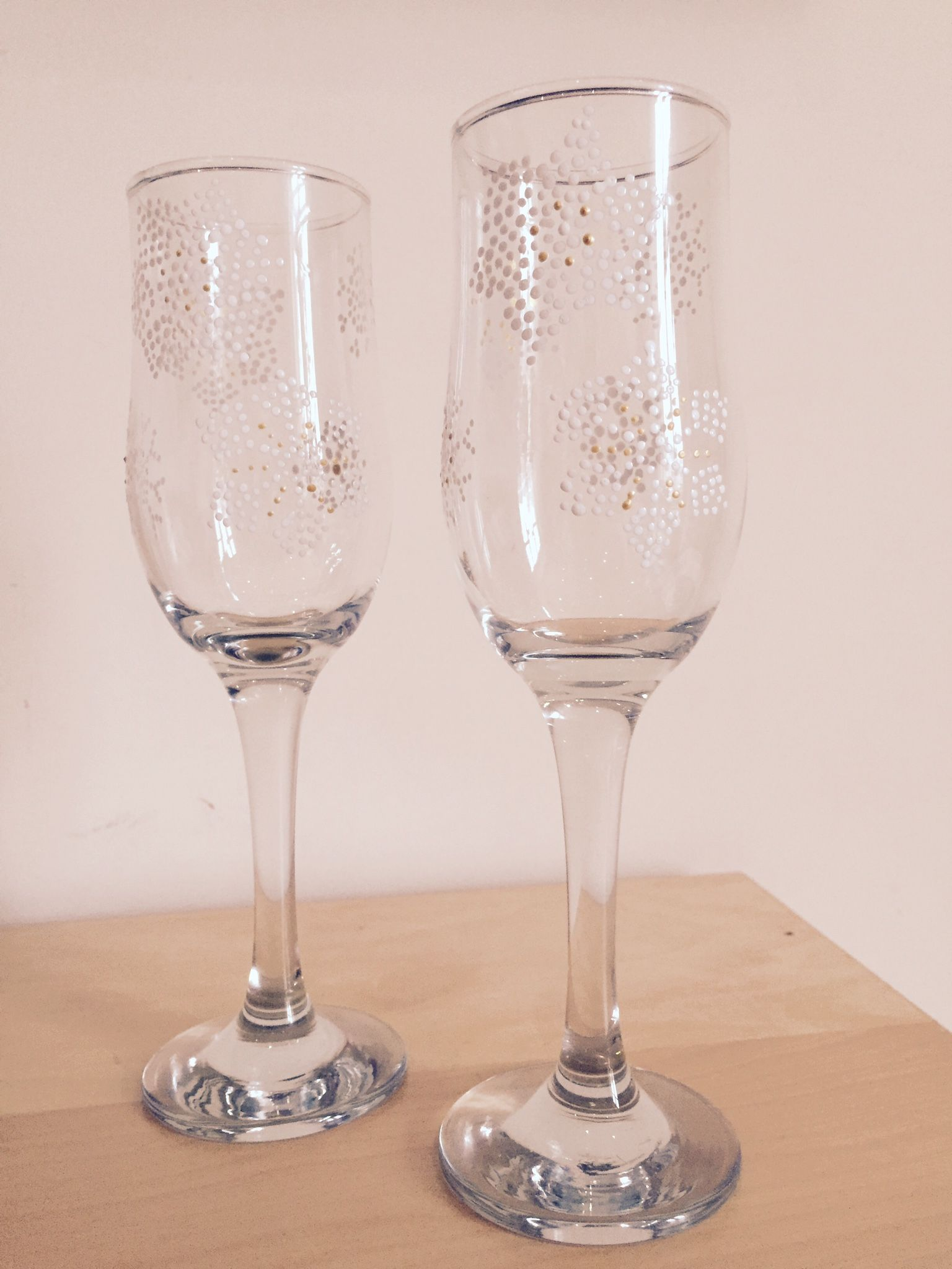 Snowflake champagne glasses for the new year.  They can do any pattern you would like on any shape glass!
