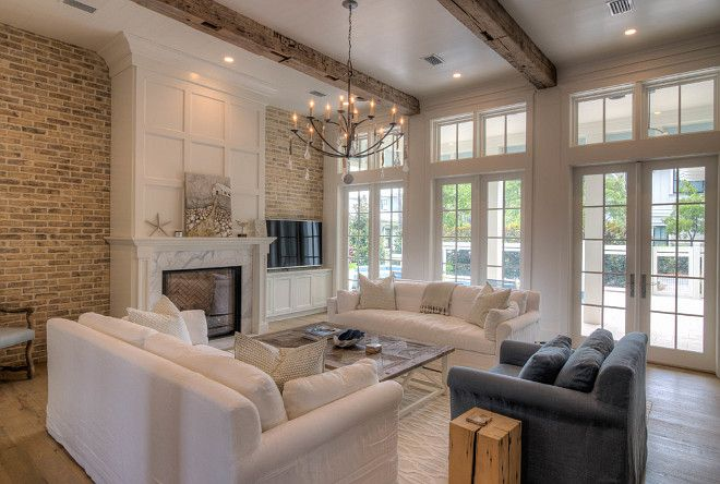 Living Room With Fireplace Reclaimed Brick Wall Wood Beams Bleached Wide Plank Floors And French Doors Transoms