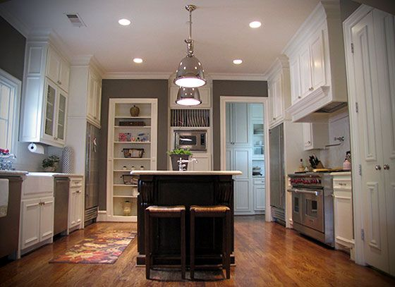 light grey kitchen walls, Gray kitchen walls, white cabinets, light fixtures above