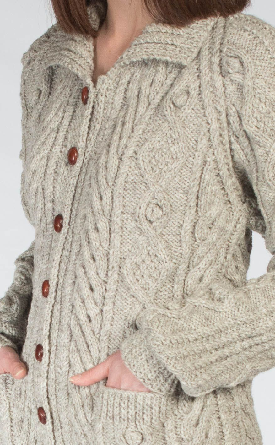 c2383107e2b0d8 With great handknitted detail this Aran cardigan is perfect for warming up  your everyday casual wear when winter comes round