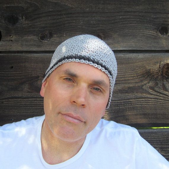 I hand crocheted this kufi cap with pure gray hemp yarn and accented it with stripes of charcoal and black hemp...it is made for those of you who