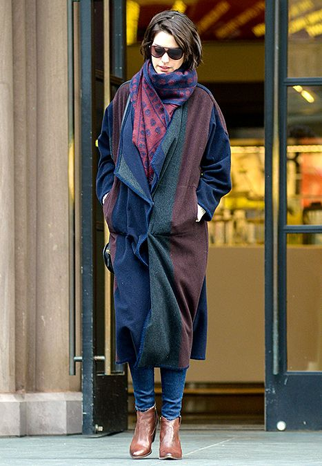 Anne Hathaway wears a skull scarf with a long wool coat on Jan. 20.