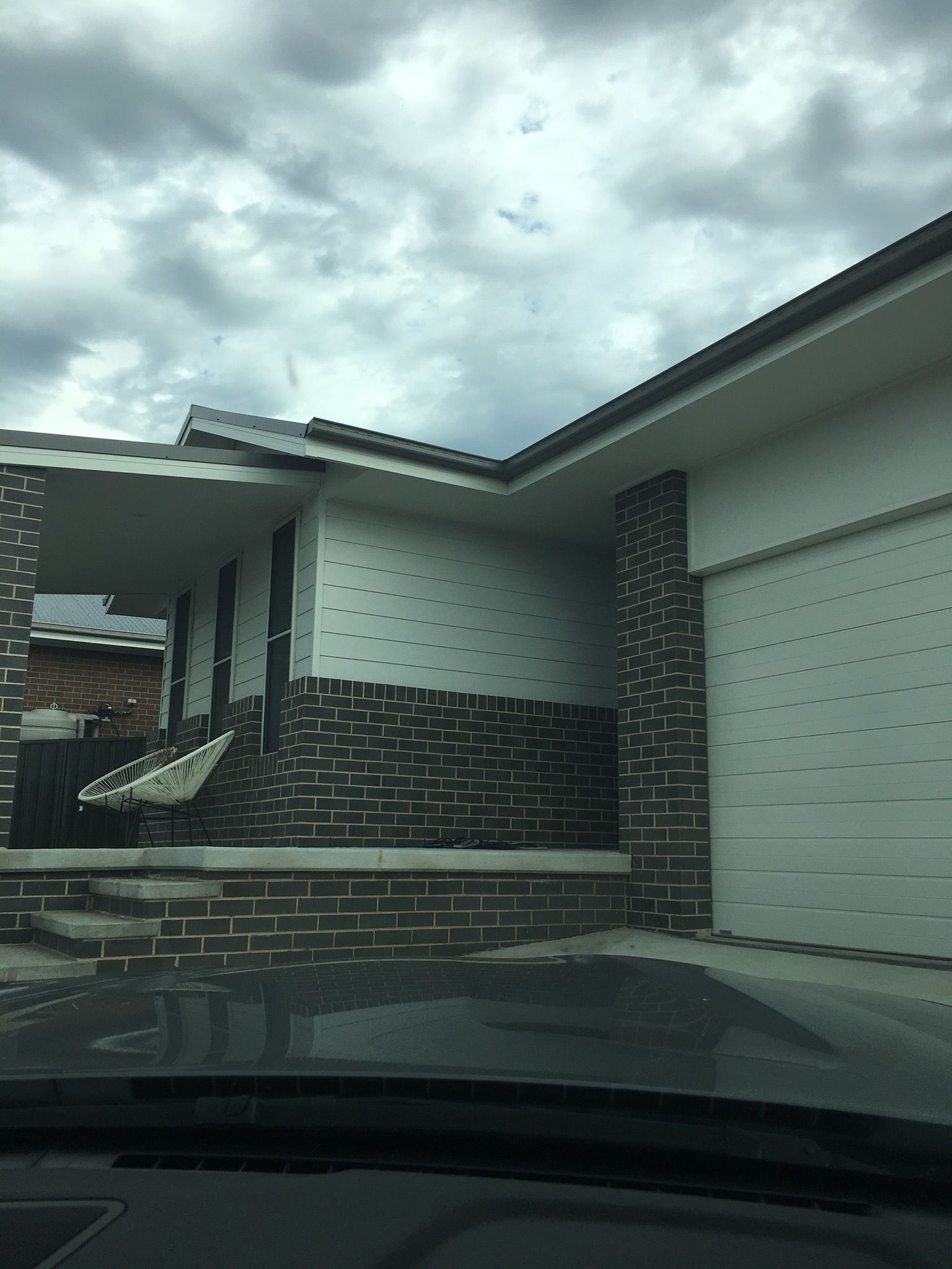 Colorbond roofing colours pictures to pin on pinterest - Striking Elevation With Feature Gable Planking Rendered Facade And Colorbond Roof